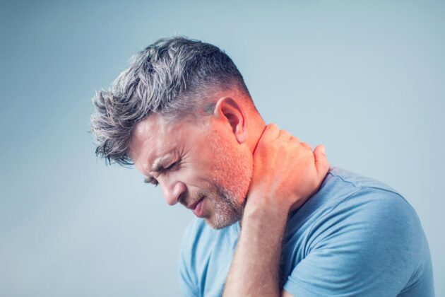 man suffering from neck pain.